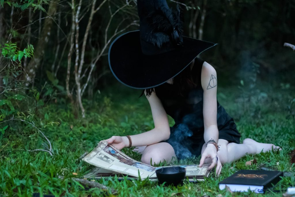 picture of a wiccan woman in a hat