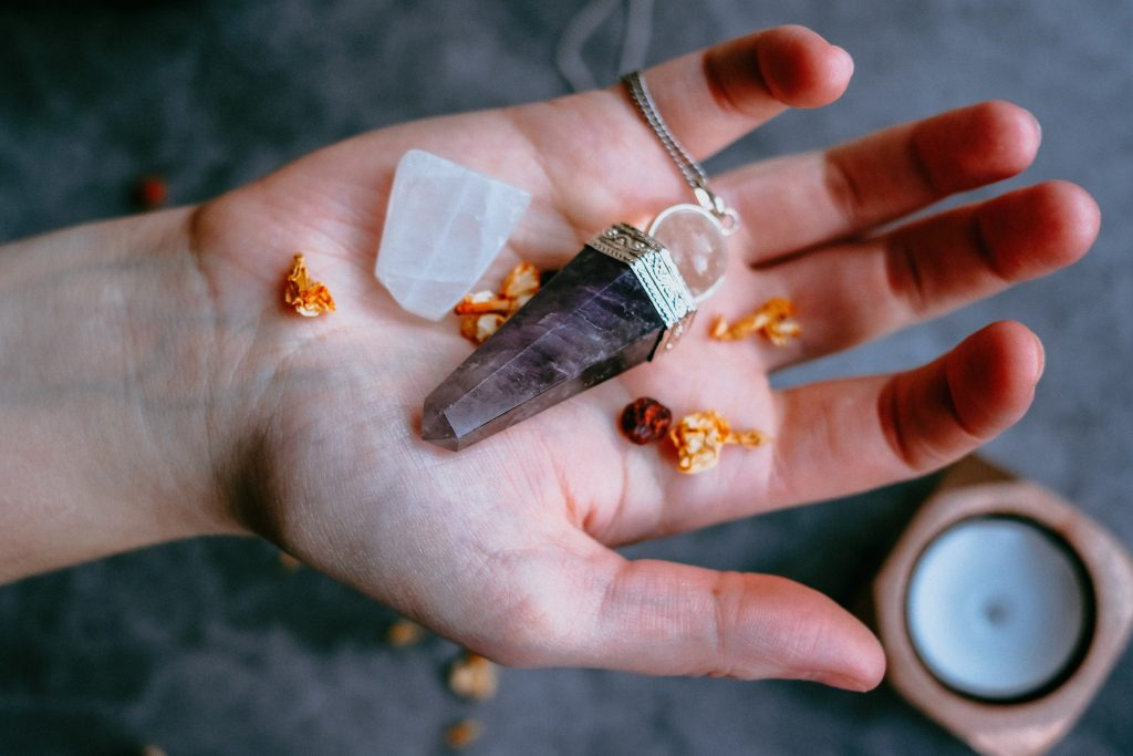 Image showing supplies for a healing ritual including a crystal and a candle