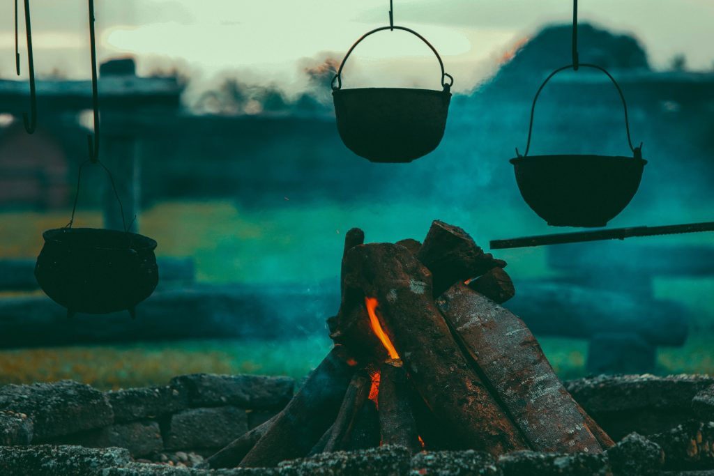 Image showing cauldrons hanging over a log fire