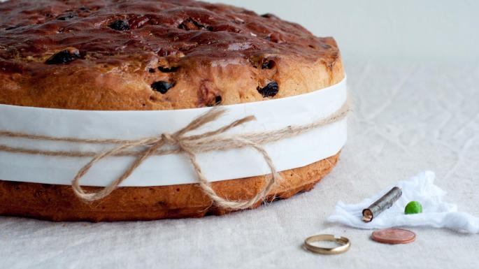 Buttermilk Barmbrack bread with common trinkets beside it