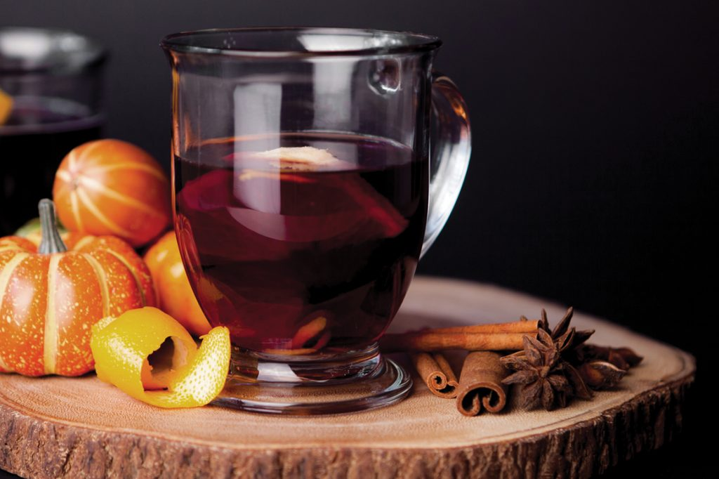 mulled wine for samhain with pumpkins in the background