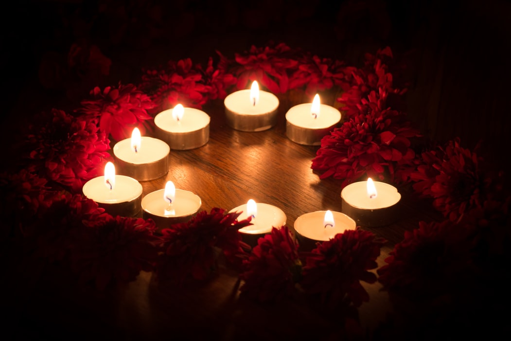 candle magic feature image candles in heart shape