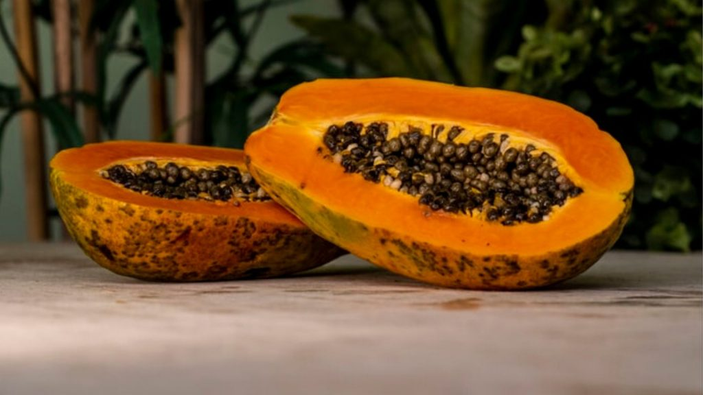 cup open papaya with seedsshowing
