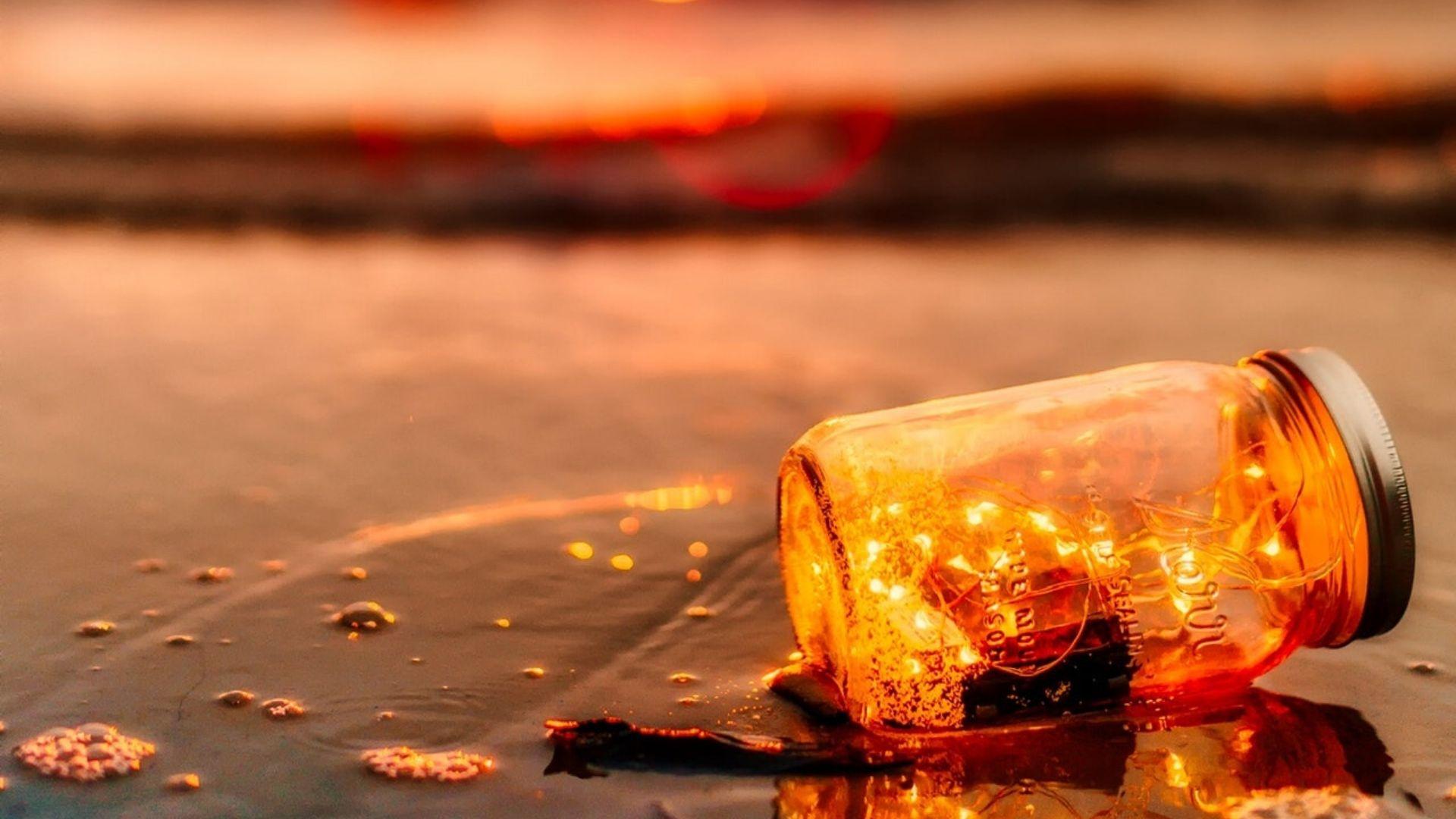 jar on the beach at dusk