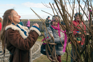woman leaving cloth strips outside for brigid to bless at imbolc