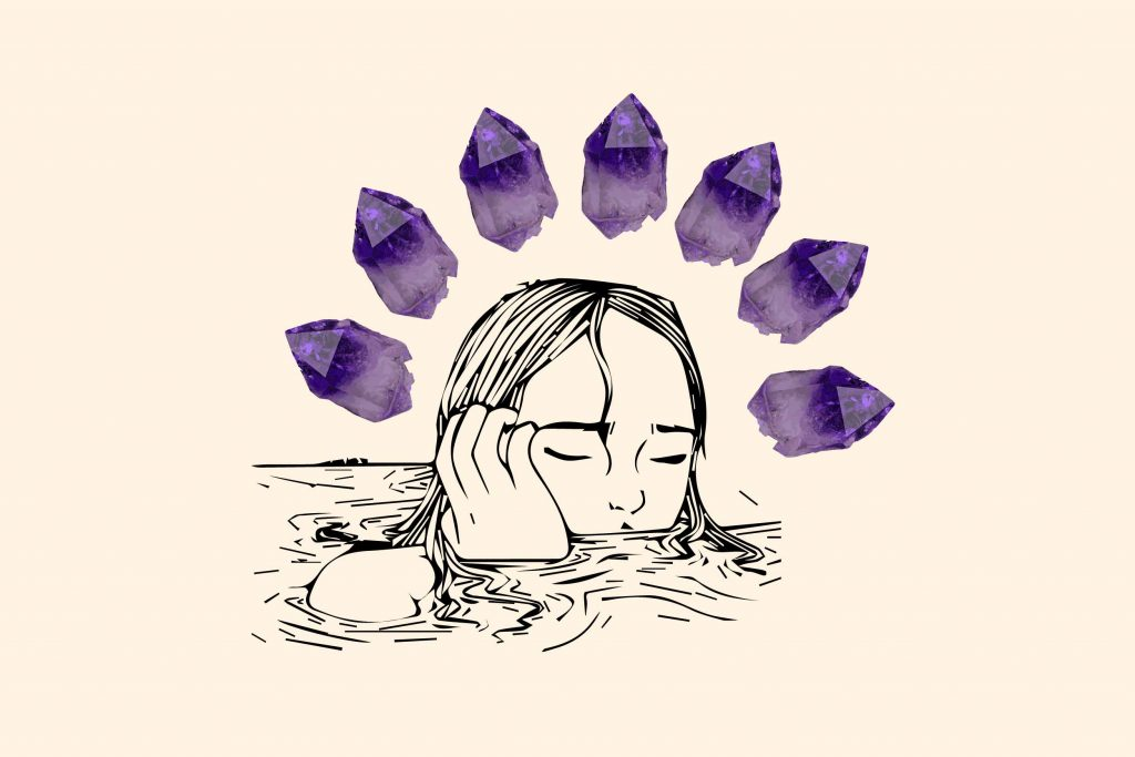 womans head coming out of water surrounded by 7 amethyst crystals