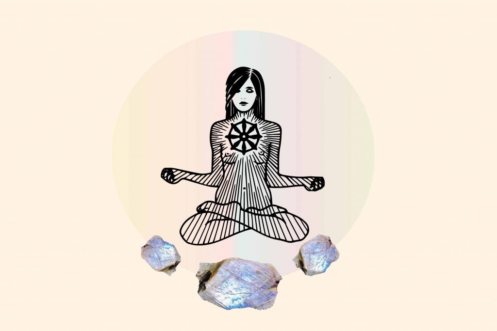 moonstone as crystal for anxiety with meditating woman sitting above 2 moonstones