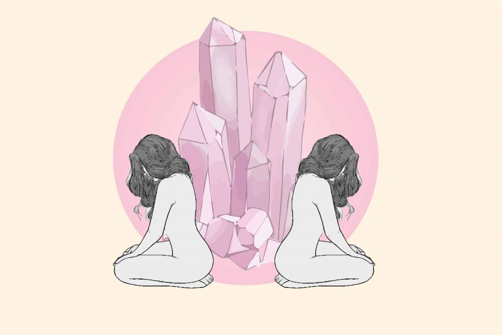 rose quartz on a pink circle with a kneeling woman on each side meditating