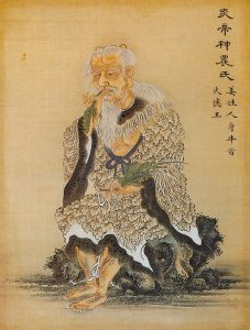 The mythical God/Emperor Shennong trying healing herbs.