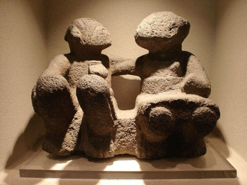 a stone carving of the god Ometeotl in its dual form as male and female