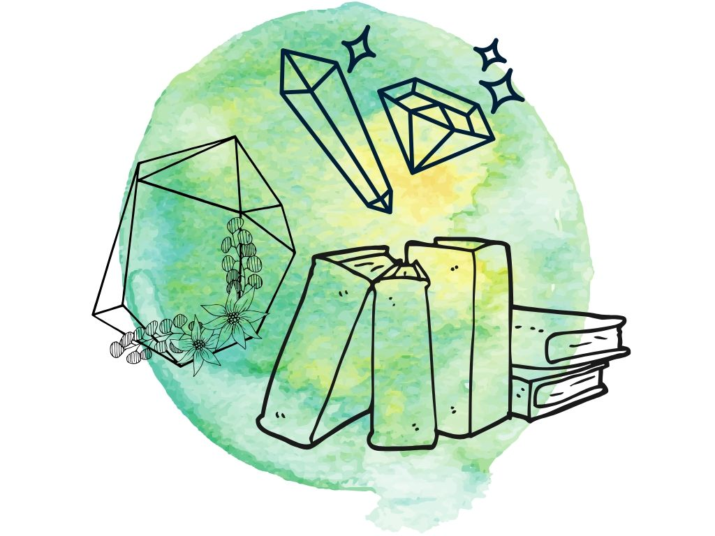 books and crystals on a green background for wiccan symbols