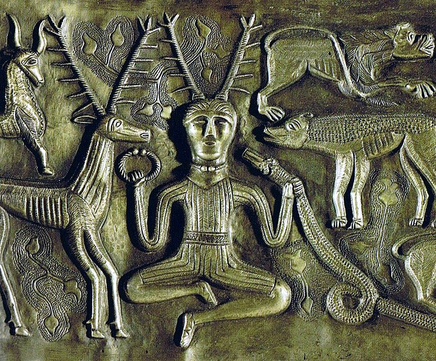 the horned god as dipicted on the  Gundestrup Cauldron