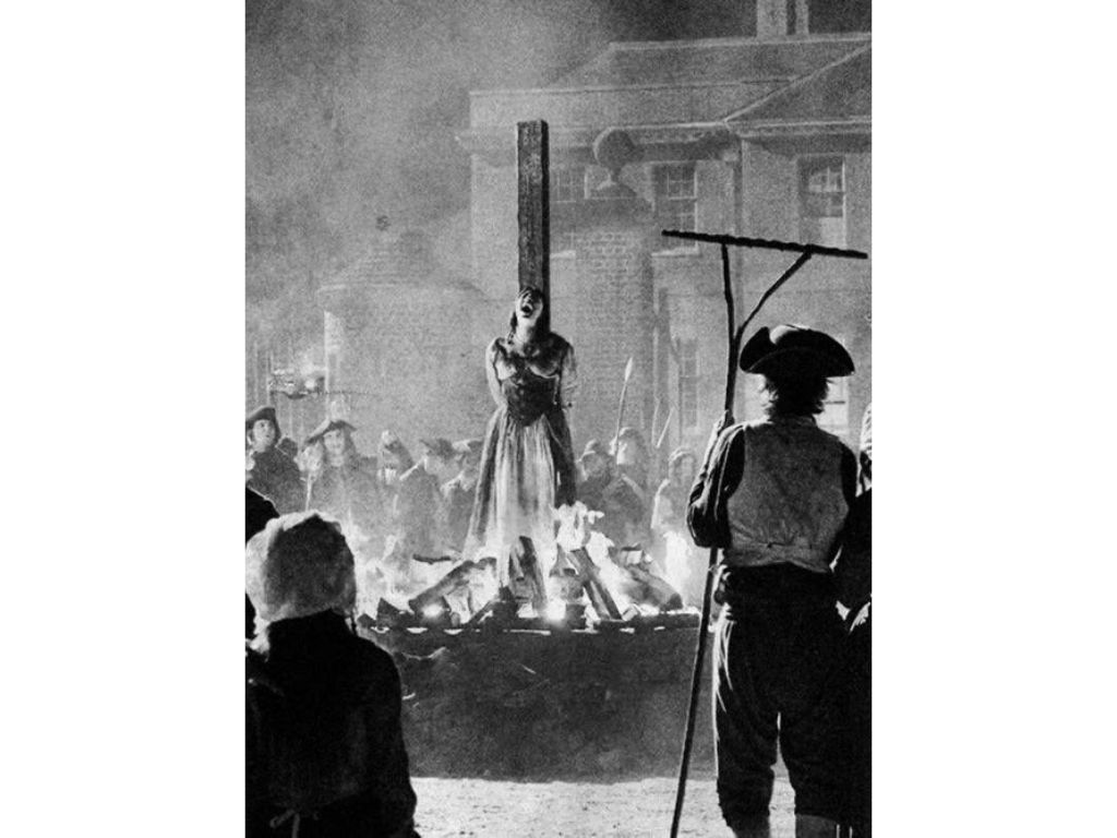a woman being burned at the stake for what is witchcraft blog post