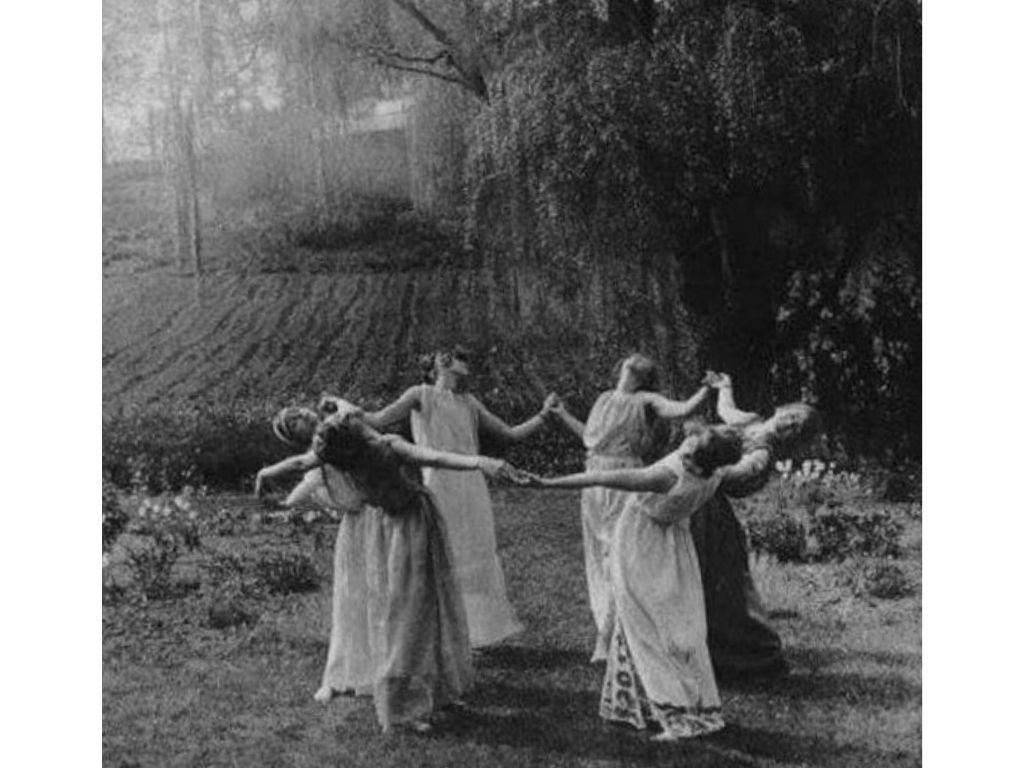 women dancing in a circle in a field for what is wicca blog post