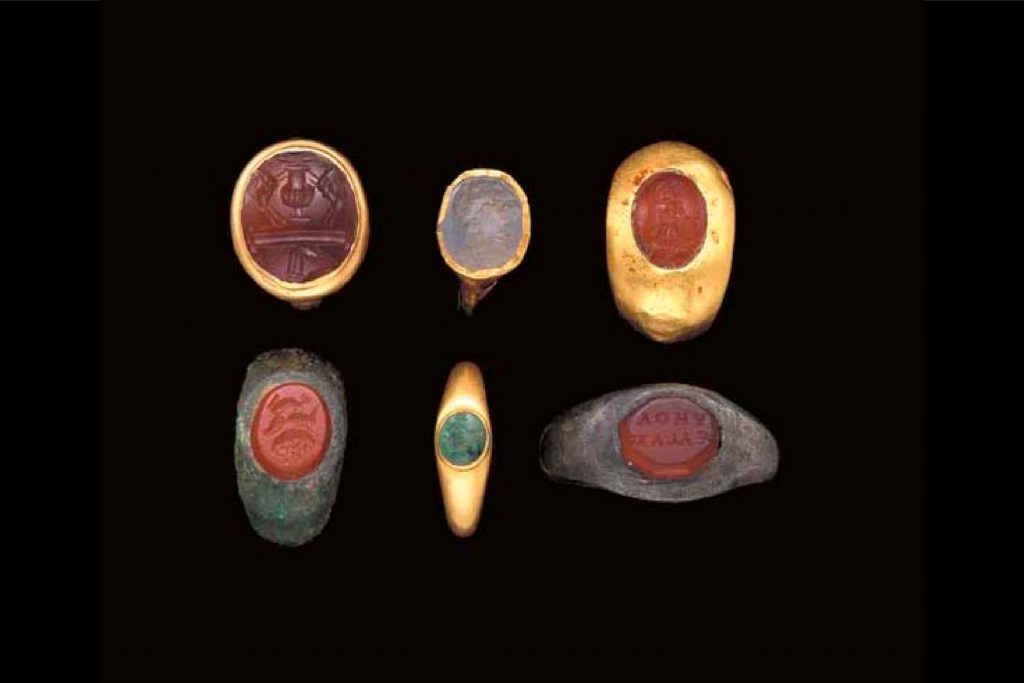 6 ancient Roman rings featuring carnelian on a black background