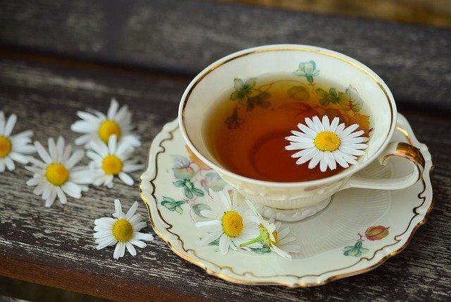 tea cup with chamomile in it