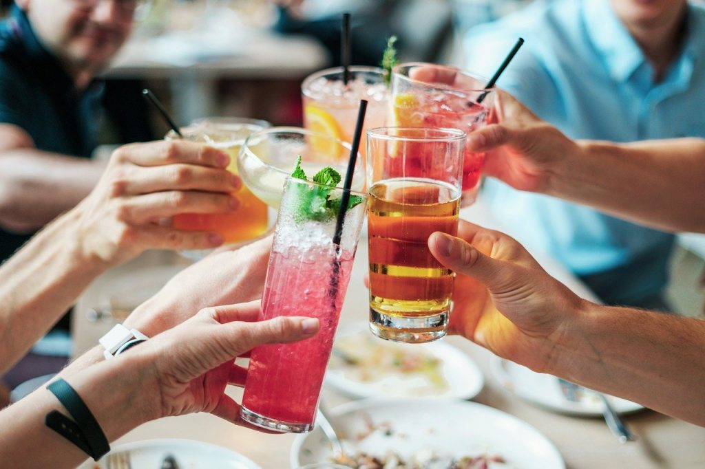 people toasting with cocktails for lammas ritual