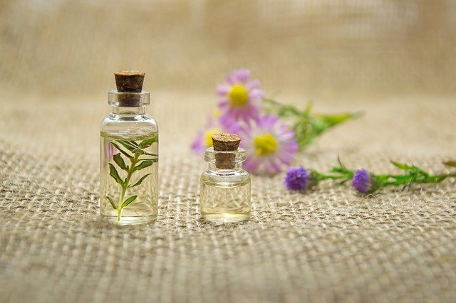 thyme oil with flowers inbackground